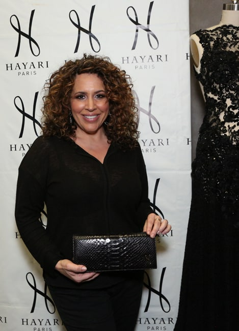 Diana Maria Riva, currently acting in the series « Telenovela » aired on NBC, holding the black evening pouch with crocodile effect from the Ephemeral Collection